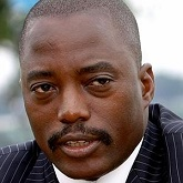 Congo's President Kabila speaks to journalists at a news conference in presidential gardens on the banks of the Congo River